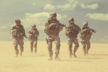United States paratroopers airborne infantrymen in action in the desert